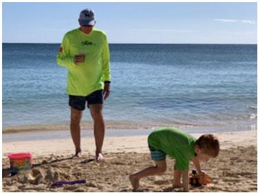 A little boy and his grandpa at the beach